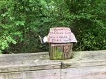 Signage on boardwalks over wetlands.